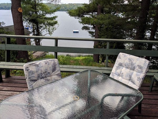 outdoor deck with patio set and lake view